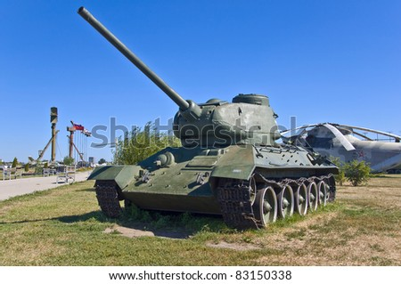 russian battle tank with blue sky in background - stock photo