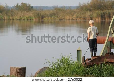 Russian boy near river - stock photo