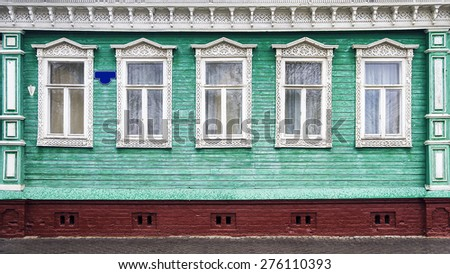 Russian carved frames of wooden houses - stock photo