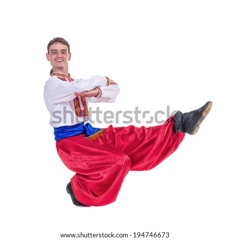 Russian cossack dance. Young dancer in ethnic clothes dancing, full length portrait isolated over white background - stock photo