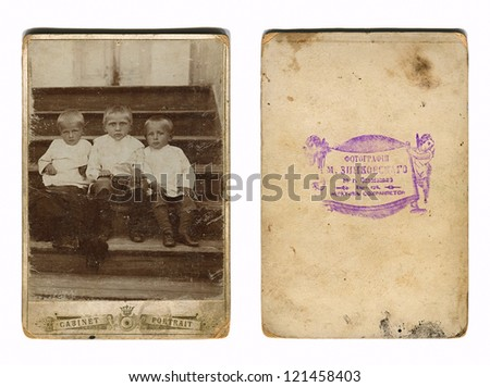 RUSSIAN EMPIRE - CIRCA 1880: Vintage photo of a group children, and its downside, circa 1880. - stock photo