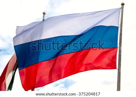 Russian flag, growing in the wind - stock photo