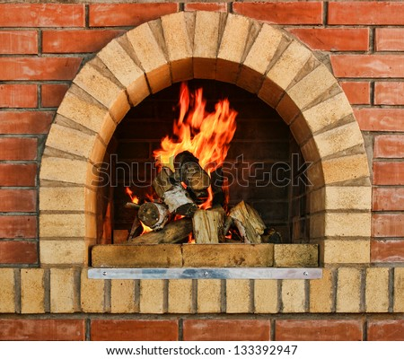 Russian interior kitchen with an oven and a burning fire - stock photo