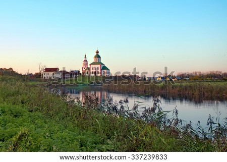 Russian landscape with river Kamenka and Church in Suzdal. Russia - stock photo