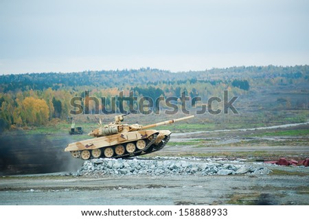 Russian military tank T-90S with Obstacle overcoming - stock photo