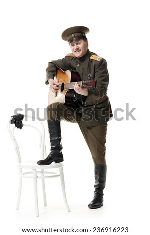 russian officer playing guitar isolated on white - stock photo
