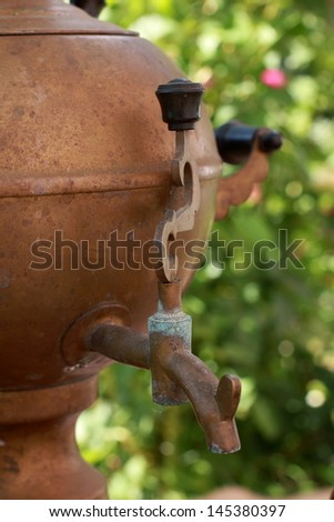 Russian old samovar, teapot, cup and beautiful  bouquet - stock photo