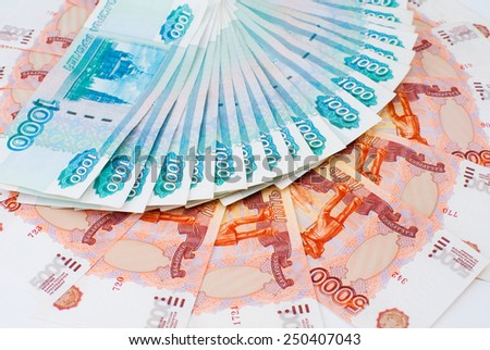 russian paper money - 1000 and 5000 rouble bills - stock photo