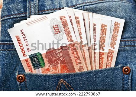 Russian paper money in pocket denim - stock photo