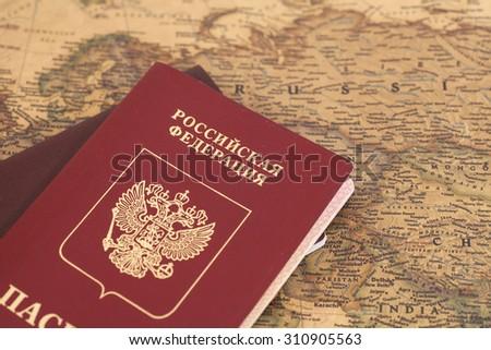Russian Passports on map close up - stock photo