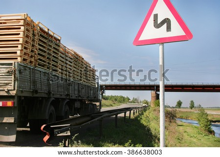 Russian road sign: winding road  - stock photo