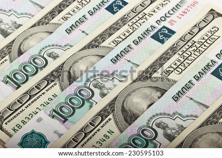 Russian rubles and US dollars. Background - stock photo