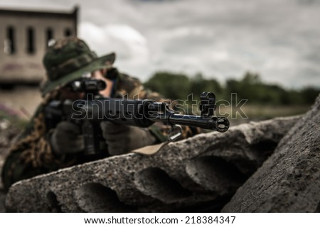 Russian sniper hidden in urban area - focus on barrel end - stock photo