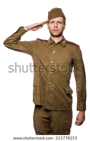 Russian soldier saluting. Studio portrait isolated on white background   - stock photo