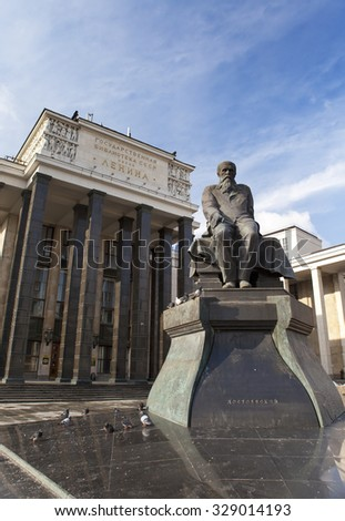 Russian State Library (Library name of Lenin) and a monument of russian writer Dostoievsky, in Moscow - stock photo