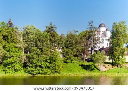 Russian summer landscape with white chuch