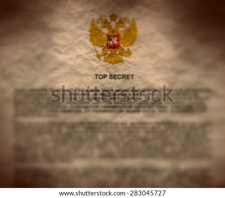 russian top secret document crumpled paper textured with russia coat of arms - stock photo