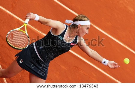 Russian top tennis player and world #4 Svetlana Kuznetsova serves during her match at French Open 2008, Roland Garros. Paris, France. - stock photo