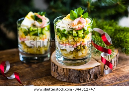 Russian traditional salad Olivier with fresh cucumber - stock photo