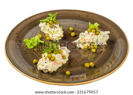 Russian traditional Salad on a plate. Isolated on white background. - stock photo