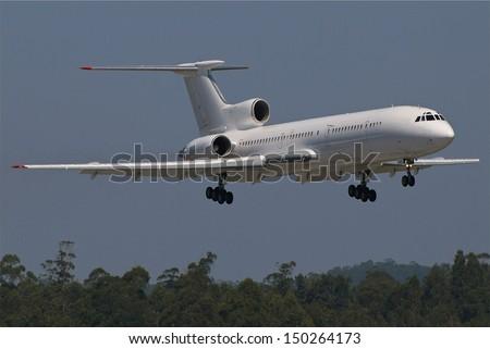 Russian Tupolev airplane landing - stock photo