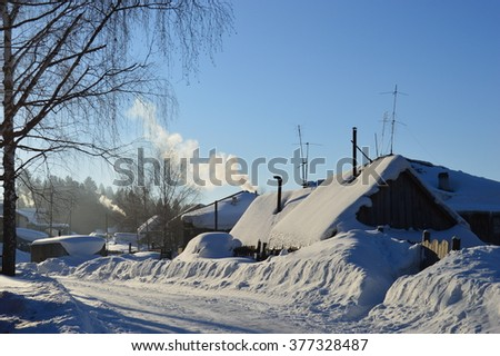 Russian village in the winter. Ural. - stock photo