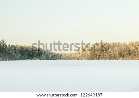 Russian winter lake in ice and snow - stock photo