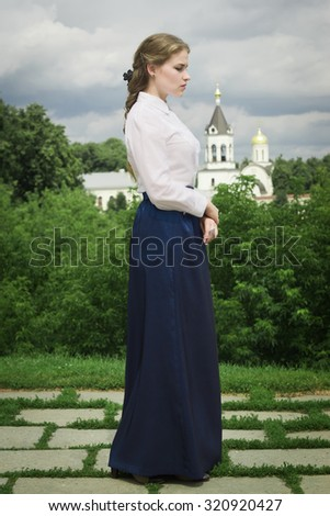 Russian woman in retro style posing on the street. Outdoor vintage portrait. - stock photo