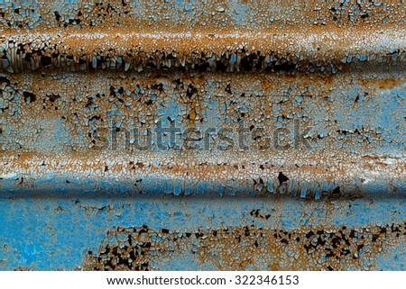 Rust flaking paintwork on old corrugated metal surface in black and white abstract - stock photo