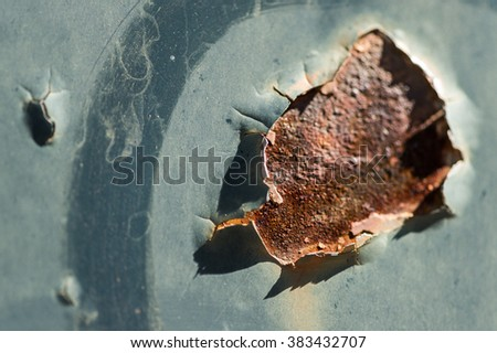 Rust hole on worn car body painting close up details as background image - stock photo