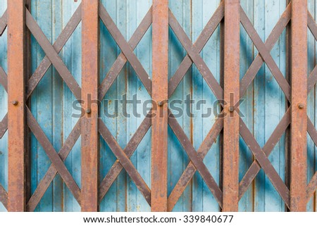 Rust on steel slide door, rust background - stock photo