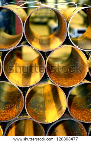 Rust steel pipes in warehouse - stock photo