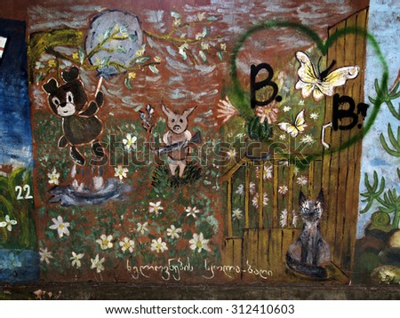 RUSTAVI, GEORGIA - May 1, 2014: Graffiti on the theme of the tales of Winnie the Pooh and his friends - stock photo