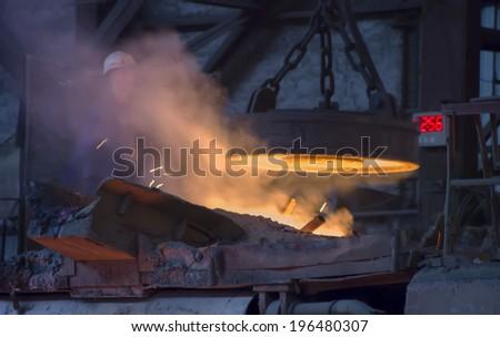 RUSTAVI, GEORGIA - May 1, 2014: Hot steel pouring in Rustavi Metallurgical Plant, Georgia  - stock photo
