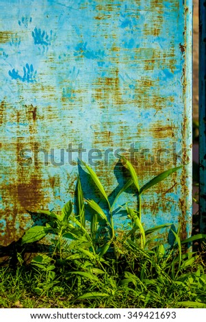 Rusted blue-green painted metal wall - stock photo