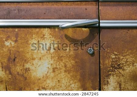 Rusted Car Door - stock photo