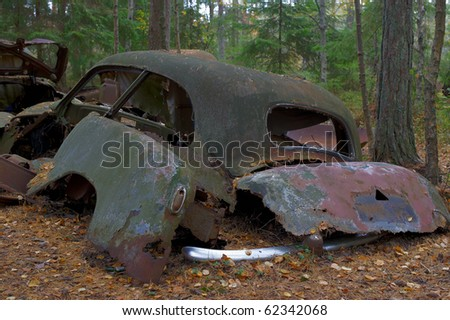 Rusted cars Detail from the Junkyard - stock photo
