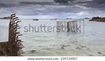Rusted hoop nets coastline, France, Atlantic ocean - stock photo