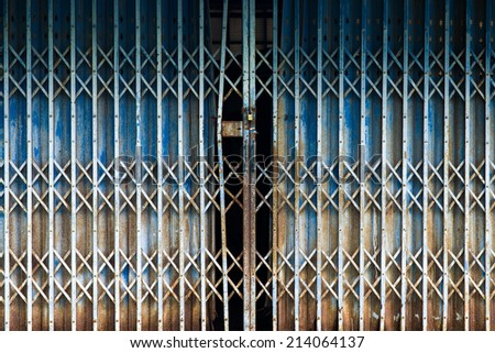 Rusted Metal Folding Door Background Texture - stock photo