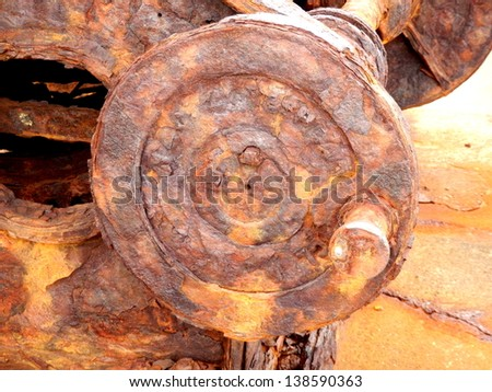 Rusted pulley wheel - part of a steam winch located at the old Pier Wilson Coal Wharf at Funchal on the island of Madeira - stock photo