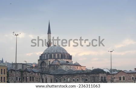 Rustem Pasa Mosque in Istanbul - View of the Minaret and the central Dome from the Southeast - Istanbul, Turkey, Europe - stock photo