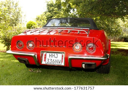 RUSTENBURG, SOUTH AFRICA - FEBRUARY 15:  Red 1973 Chevrolet Stingray Corvette Rear View in Private Collection Philip Classic Cars on February 15, 2014 in Rustenburg South Africa.    - stock photo