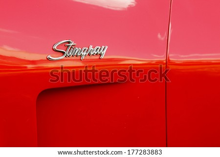 RUSTENBURG, SOUTH AFRICA - FEBRUARY 15:  Red 1973 Chevrolet Stingray Corvette Side Insignia in Private Collection Philip Classic Cars on February 15, 2014 in Rustenburg South Africa.    - stock photo