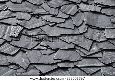 Rustic background of decorative black schist blades - stock photo