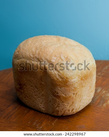 Rustic bread french, wheat  on old table. Rural kitchen or bakery. - stock photo