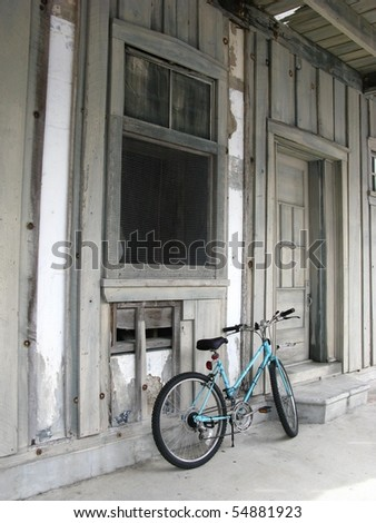 Rustic Building and Bicycle - stock photo