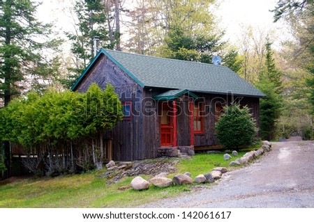 Rustic cabin sits along the path on a beautiful spring day - stock photo