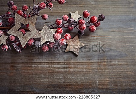 Rustic Christmas decorations on wooden surface; seen from above - stock photo