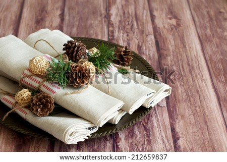 Rustic Christmas table place setting - stock photo