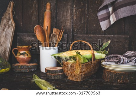 Rustic dark farmhouse image with various harvest veggies and kitchen vintage spoon.  - stock photo